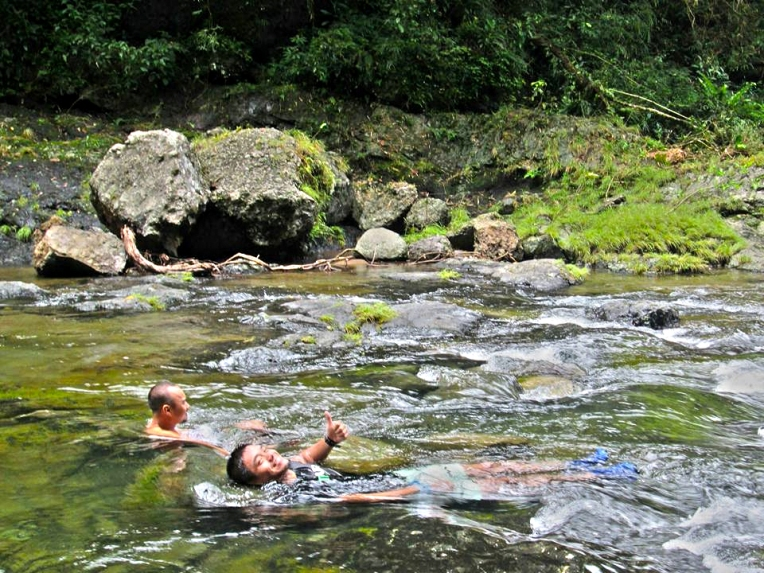 Relaxing in the VERY cool river water