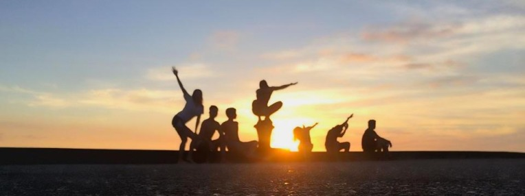 The group playing with silhouettes as the sun set