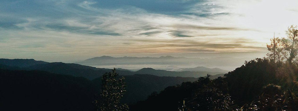 Distant sea of clouds and the sunrise from Indupit village