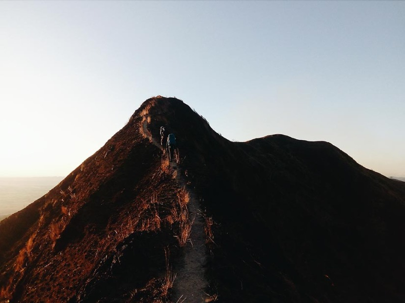 Walking up and down ridges as the sun sets